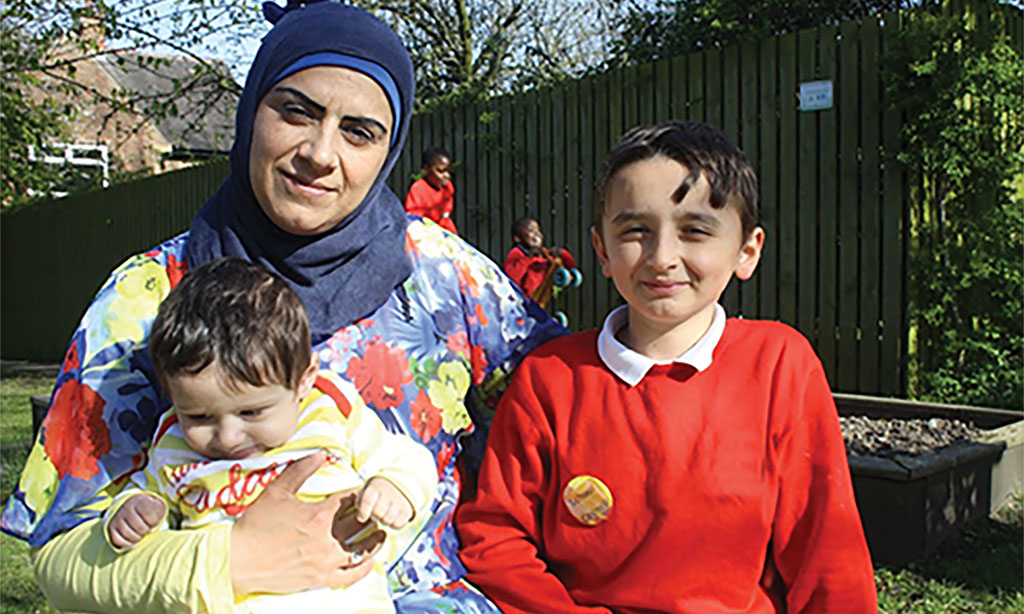 Syrian refugee Jana and her sons Ahmed and Amir in the park