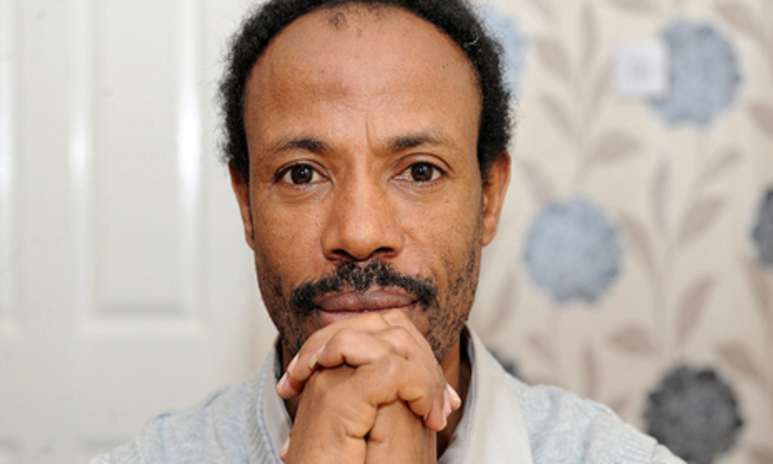 Portrait photo of Abebe, a refugee from Ethiopia