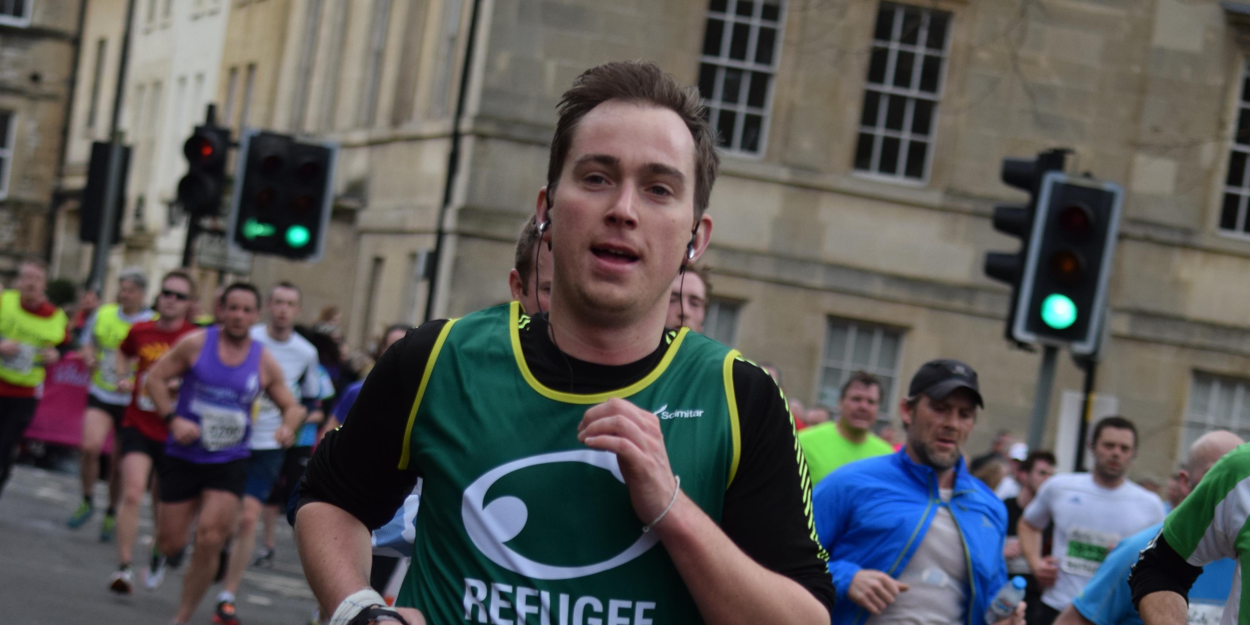A Refugee Action runner runs a race