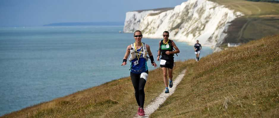 Picture of two runners on the Isle of Wight coastal path.