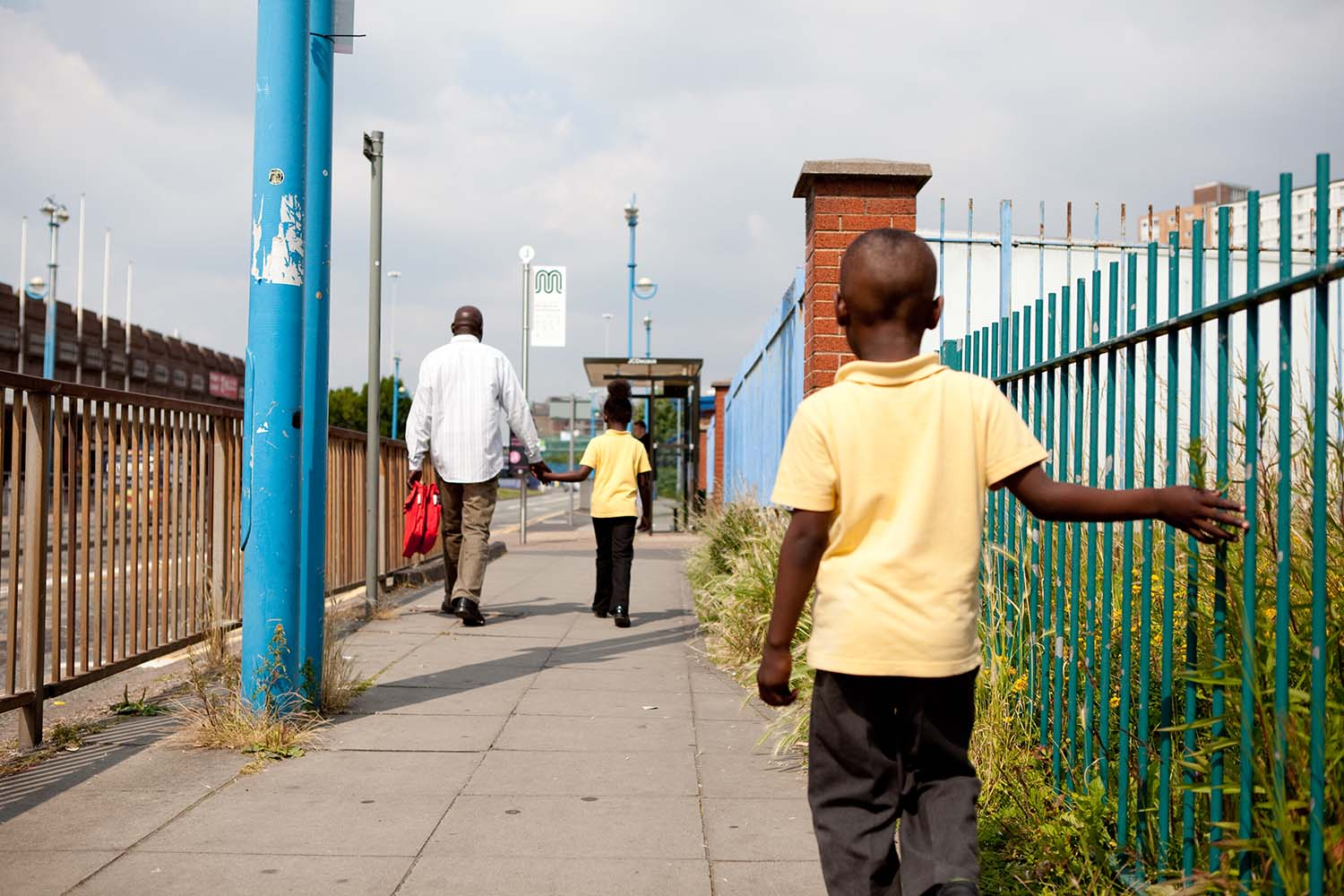 Adam, a refugee living in the UK walks home from school with his family. Photo Refugee Action