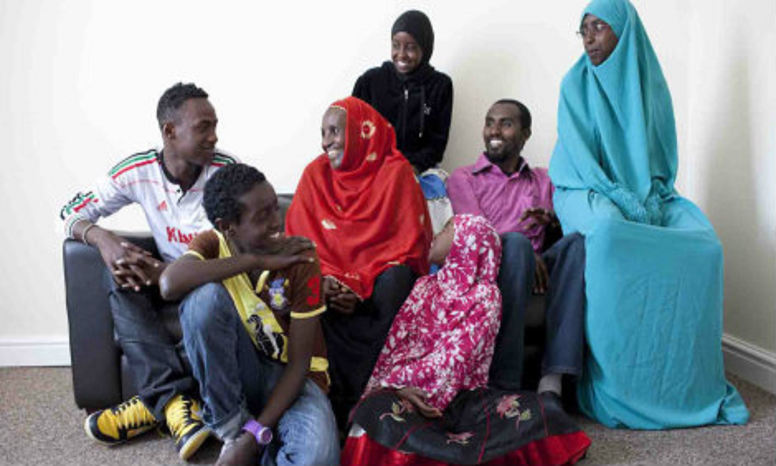 Adem, a refugee from Ethiopia, with his family