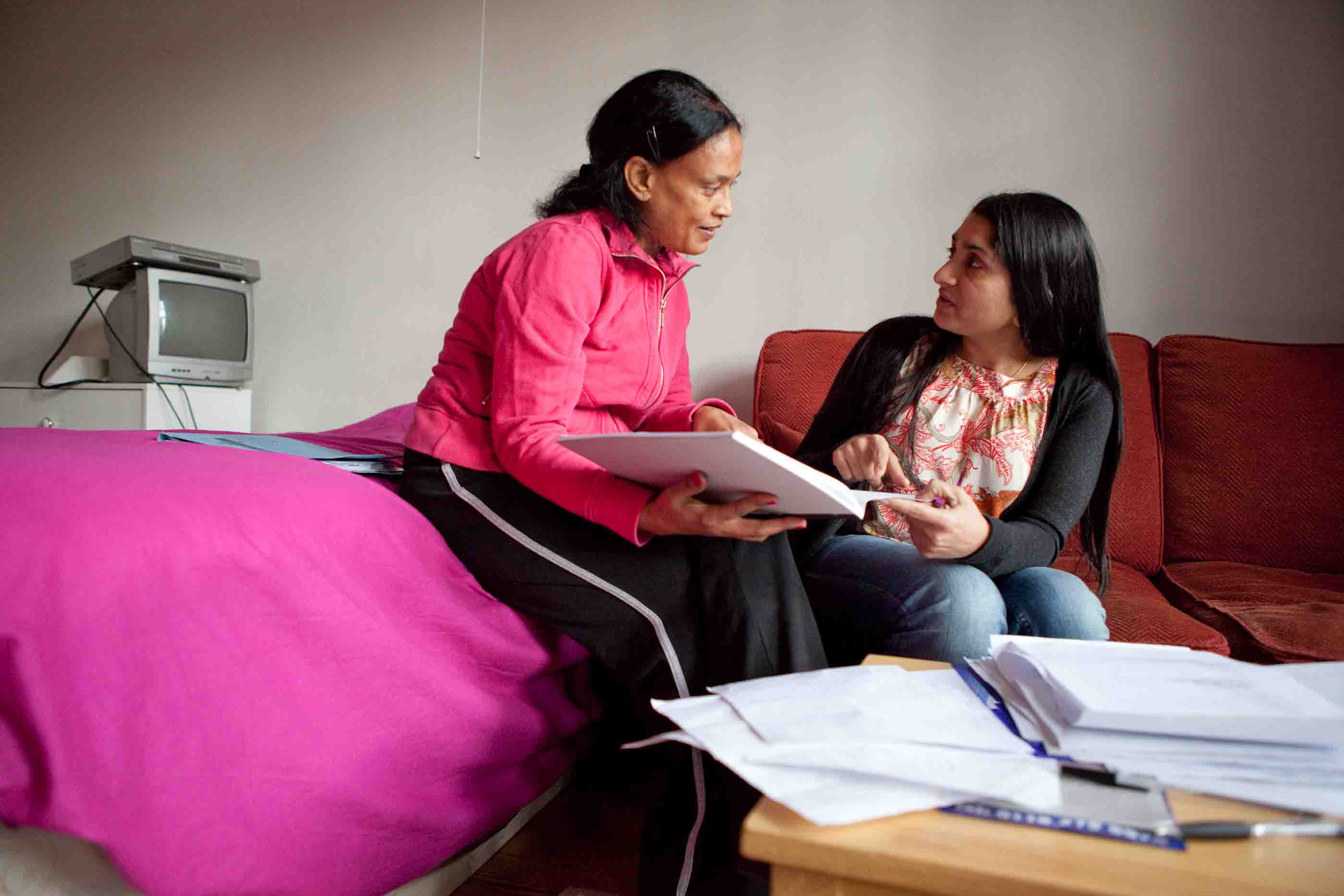 Picture of a woman talking to a Refugee Action advice worker.