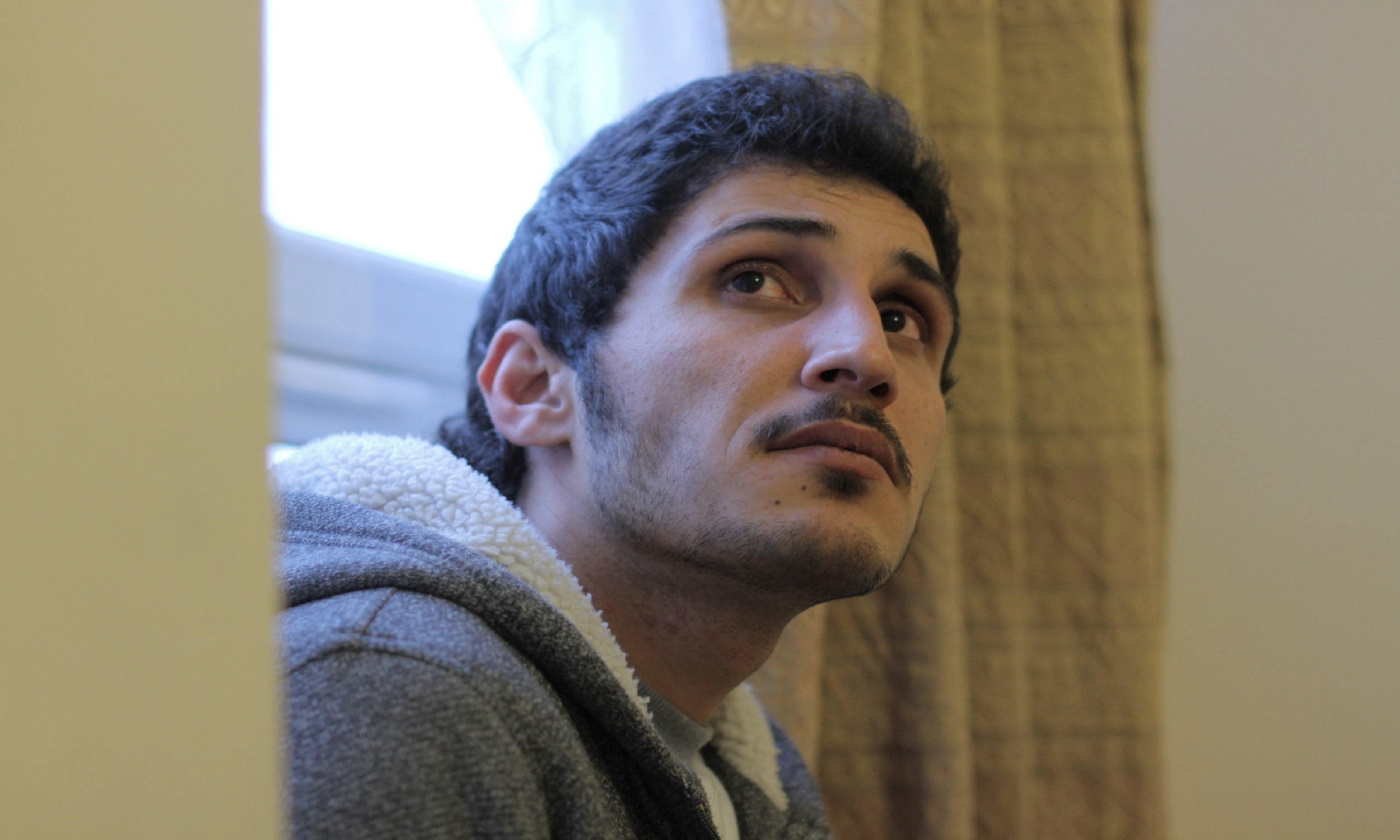 A close up photo of Dariush, a refugee from Iran