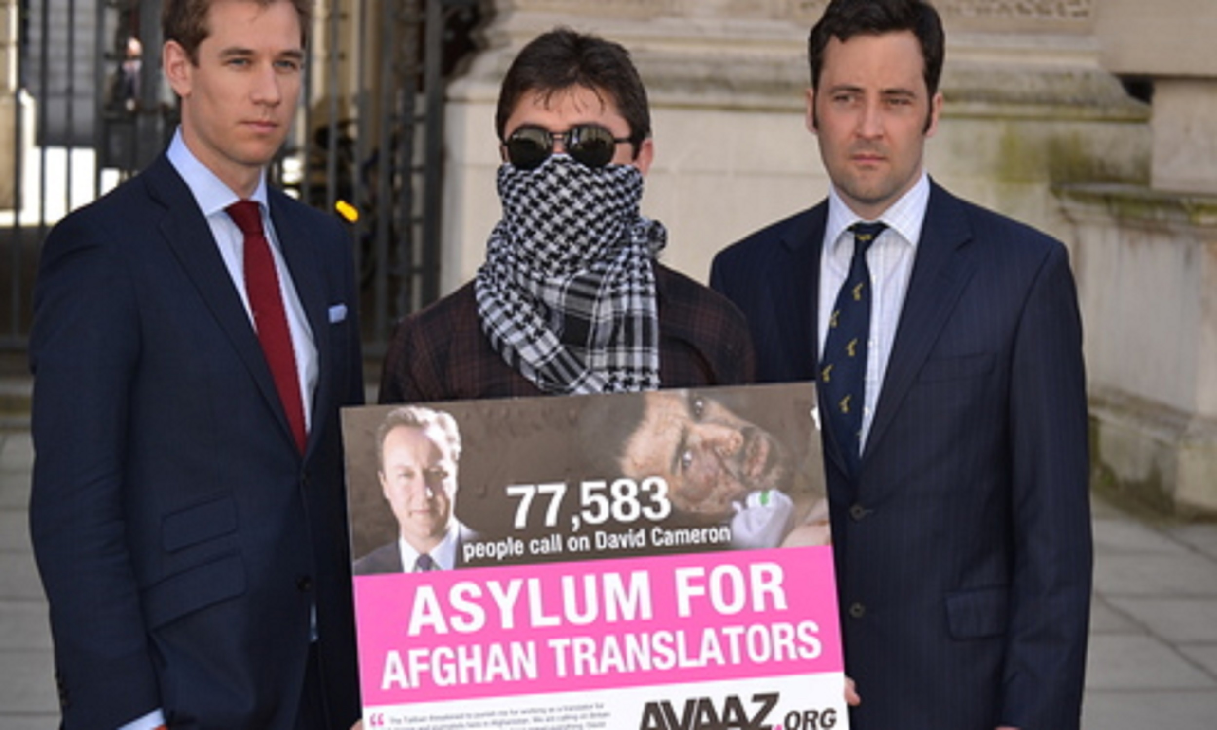 Rafi, a refugee from Afghanistan, campaigning for afghan interpreters outside government buildings