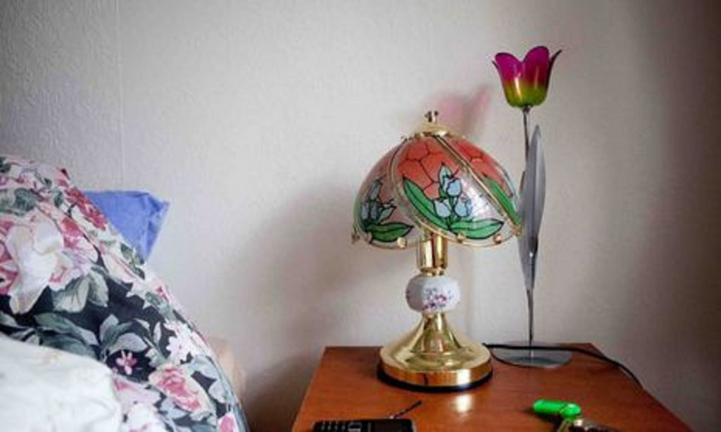 Image of a colourful lamp on a bedside table