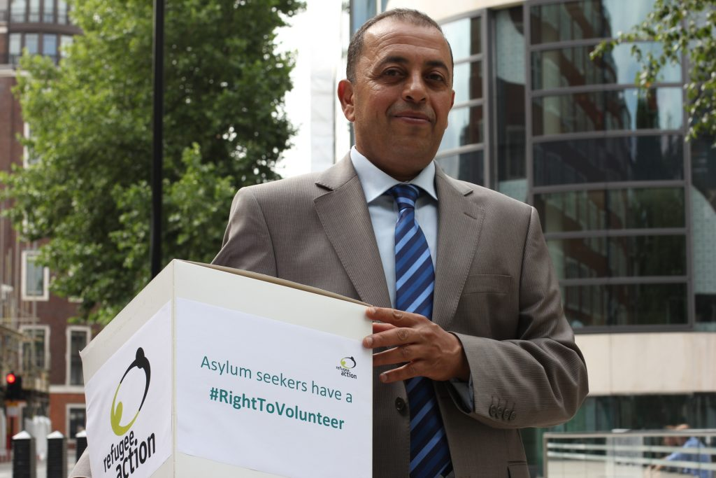 Refugee Action volunteer Nabil hands in the right to volunteer petition to the Home Secretary Photo Refugee Action