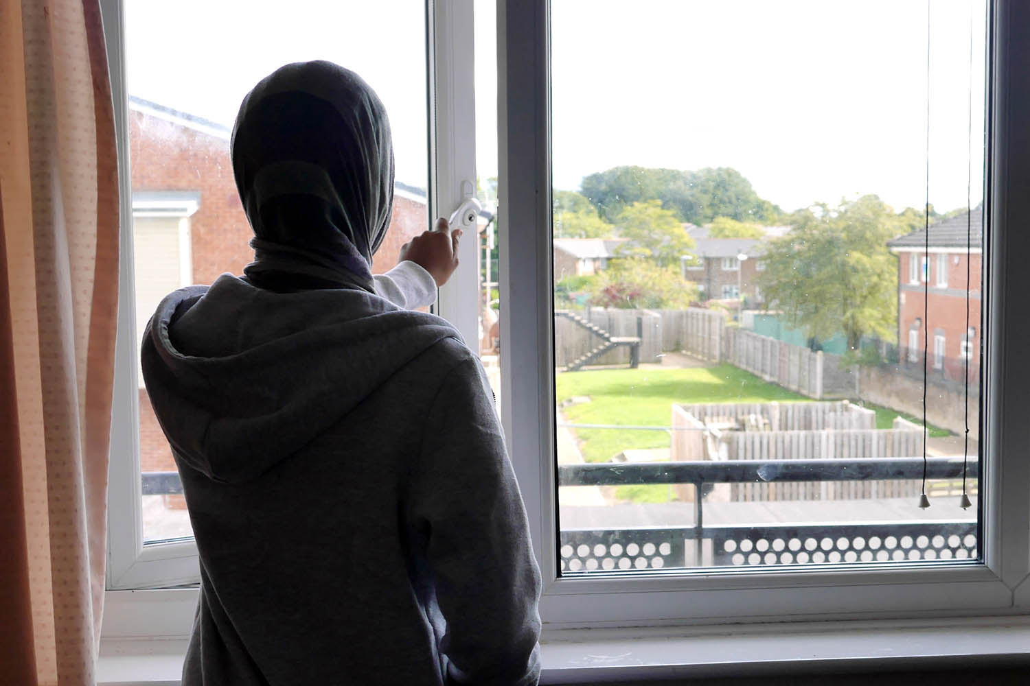 Refugee, Fathy, looks out her window